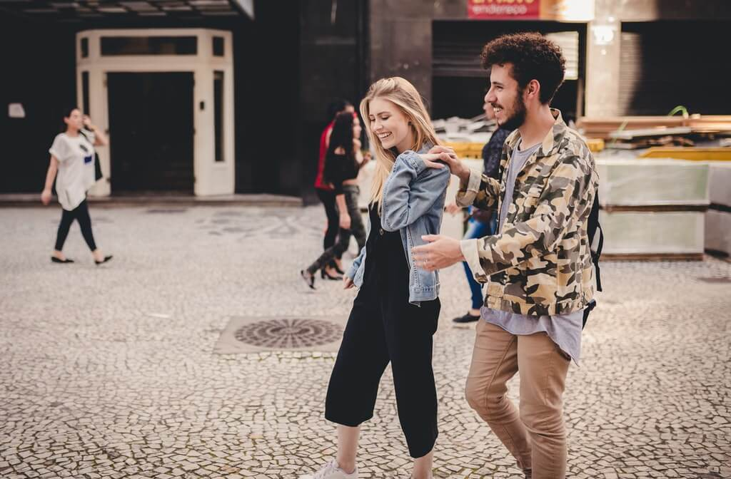 A photo of a happy couple walking, how to help someone with addiction, how to help an addict, how addiction affects your family, effects of addiction on family and friends, addictions may alienate friends