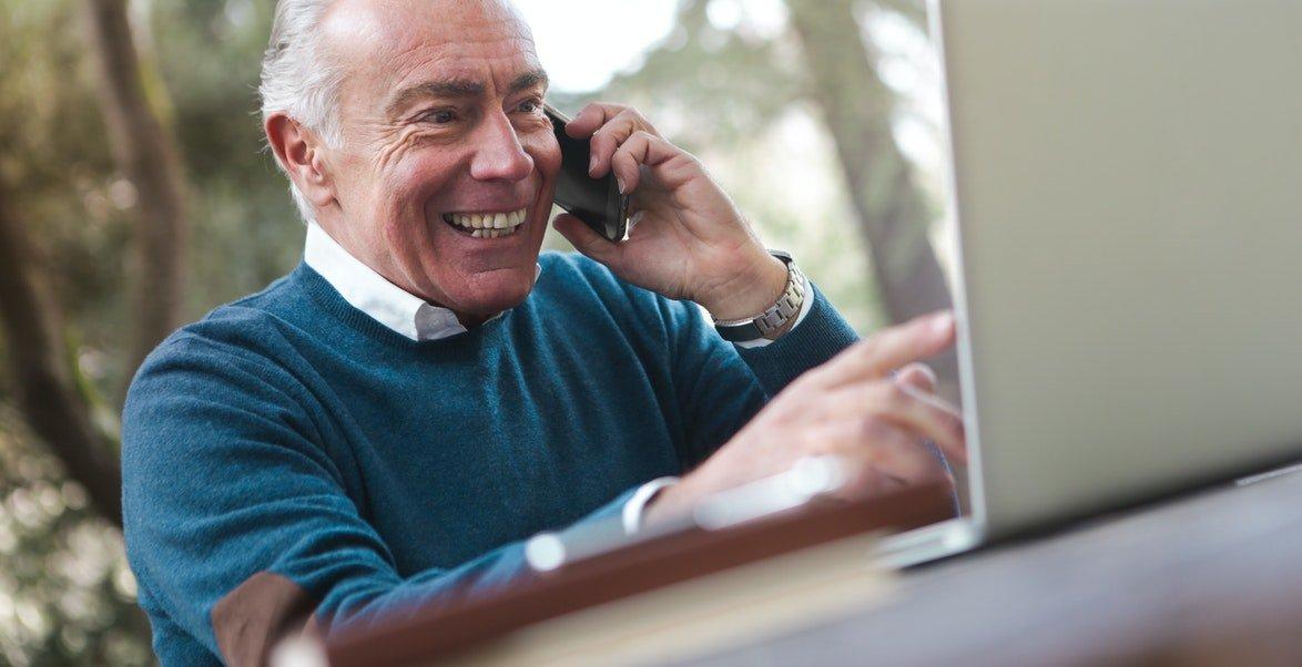 an elderly man making a video call, drug rehabs west palm beach, rehab centers west palm beach, drug rehab palm beach